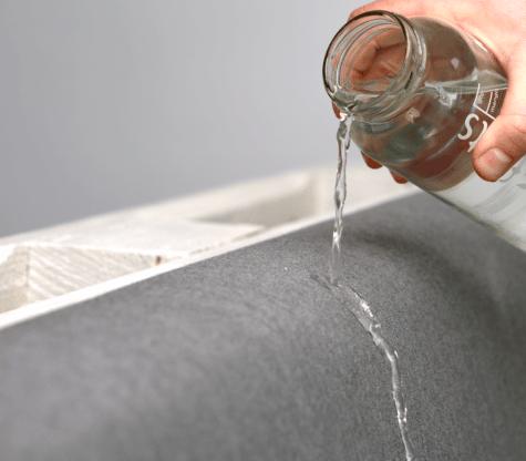 wasserabweisende Palettenkissen getstet mit Glas Wasser